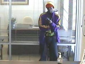 Fayetteville polcie released this surveillance photo of a man suspected of robbing the Lumbee Bank, 6313 Raeford Road, around 3:30 p.m. on Oct. 14, 2011.