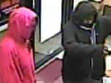 Raleigh police are looking for the men seen in these surveillance images. They are wanted in the robbery of the Papa Johns, 5260 Capital Blvd., on Oct. 26, 2011.