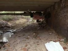 A jogger on the Bolin Creek Trail in Chapel Hill Saturday morning found a 24-year-old man lying in the creek near a bridge where neighbors say people have set up a makeshift camp.