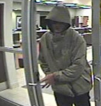 Raleigh police released this surveillance camera photo of a man who robbed a State Employees' Credit Union branch, at 4050 Poole Road, around 5:15 p.m. Thursday, Dec. 8, 2011.