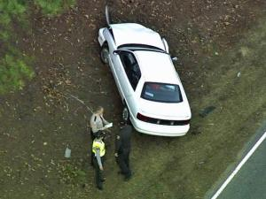 A 1996 Oldsmobile crashed into another vehicle on N.C. 42, near Buffalo Road, after a chase on Tuesday, Dec. 13, 2011. Miguel Cordell Chestnut, 24, and Gloria Ann Foust, 32, were arrested after the chase.