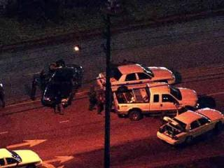 Police surrounded a vehicle in Wilson Dec. 15, 2011, where a man with a gun was threatening suicide.