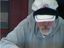 Jan. 17 surveillance video of a bank robbery suspect at the SunTrust Bank branch at 7320 Creedmoor Road.