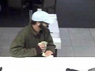 Garner police are searching for a man who entered a Wells Fargo branch at 1301 Fifth Ave. on Jan. 19, 2012, handed a note demanding money to a teller and fled with an undisclosed amount of cash.