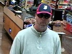 Authorities are trying to identify a man, pictured in a Nov. 25, 2011, surveillance photo at a SunTrust Bank branch in Cary, that they believe has robbed at least three Wake County banks.