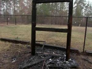 Someone set fire to a bulletin board at Piney Wood Park in Durham Friday.