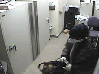 Clayton police were searching for a man who shattered the front doors of two banks on Feb. 16-17, 2012, and stole coins from one.