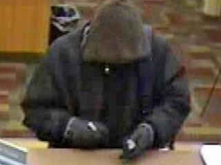 Surveillance images show the man suspected of robbing a bank in northeast Raleigh on Friday, March 2, 2012.