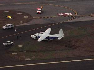 A small plane carrying three people made a hard landing at Raleigh Durham International Airport Monday evening, according to an airport spokesman. The CASA aircraft had some mechanical issues while it landed, causing it to skid off the runway into the grass.