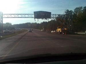A damaged sign causes major delays on Interstate 540 between Honeycutt and Six Forks roads Thursday morning, March 29, 2012. (Photo courtesy of @pfitzmsn)