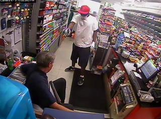The Moore County Sheriff's Office released photos from surveillance cameras of a gunman who robbed the Mac Food Store, 735 Sand Pit Road in Aberdeen, around 9:15 p.m. Sunday, April 8, 2012.