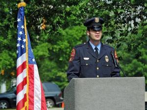 Raleigh police Officer Adam W. Young, who was shot in the line of duty in February, delivers the keynote speech during a memorial ceremony for fallen Wake County law enforcement officers on May 16, 2012. (photo courtesy of the Raleigh Police Department)