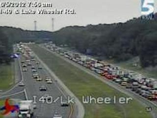 A single-car wreck on Interstate 40 East near Lake Wheeler Road in Raleigh early Tuesday, June 5, 2012, caused traffic delays during the morning commute and sent two people to the hospital.