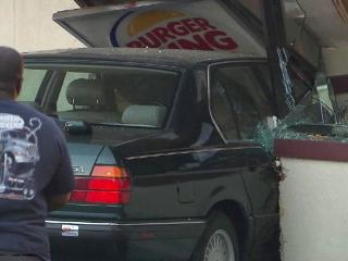 A car came crashing through a Burger King restaurant in Raleigh Thursday evening, witnesses said.