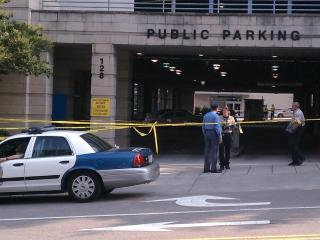 Raleigh police investigate a death near the Raleigh Convention Center Thursday morning, June 21, 2012.