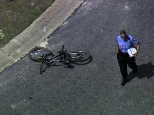Fayetteville police investigate a crash between a car and a 9-year-old boy on a bike on June 21, 2012.