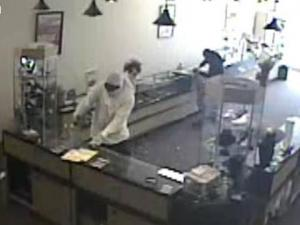 A surveillance photo shows two men robbing Diamonds & Gold jewelry store in Hope Mills on Monday, June 25, 2012.