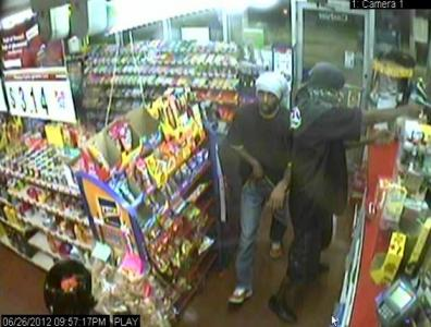 Fayetteville police are trying to identify two men, both armed with handguns, robbed the Exxon convenience store at 502 Grove St. around 10 p.m. Tuesday, June 26, 2012.