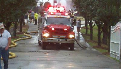 A propane tank on a gas grill exploded and sparked a three-alarm fire at a house in the  2100 block of Sam Hayes Road north of Creedmoor Sunday, July 1, 2012. (Viewer-submitted photo)