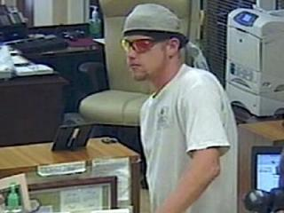 Clayton police released this surveillance video image of a man wanted in connection with a robbery at First Citizens Bank, 10702 U.S. Highway 70 W. Business on July 10, 2012.