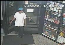 Police are trying to identify and question this man, whom they believed witnessed the robbery.