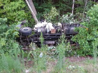 The driver of a truck was injured Tuesday evening when a tire blew out on the truck, sending it off Interstate 40, down an embankment and into a tree, troopers said.