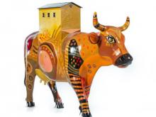 """""""Cow House,"""" seen here in its original state, is part of CowParade North Carolina 2012. More than 80 life-size cow sculptures will be on display across the Triangle through December and then will be auctioned in January to raise money for the N.C. Children's Hospital."""
