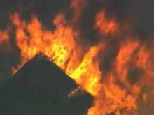Flames could be seen burning through the roof of a Durham apartment building Friday at Martin Luther King Jr. and University drives.