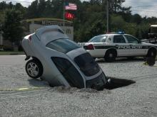 Car nosedives into sinkhole in Durham