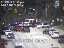 This view from a state traffic camera shows the road closure in Cary at lunchtime Tuesday. Officials closed the roadway after a truck crashed, spilling diesel fuel.