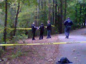 Raleigh police cordon off a section of the walking trail around Lake Lynn where a body was found on Oct. 8, 2012.