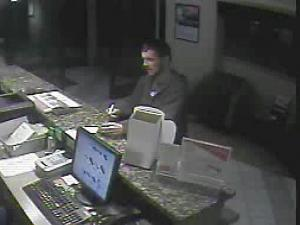 Police are searching for this man, who was caught on a security camera during a robbery at the Red Roof Inn in Chapel Hill.