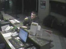 Police are searching for this man, who was caught on security video during a robbery of the Red Roof Inn in Chapel Hill.