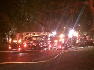 Firefighters were battling a blaze at a strip of town homes in Raleigh Tuesday night, authorities said.