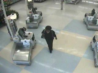 A woman wanted for questioning is seen on security video at the Market Shopping Center in Wake Forest.