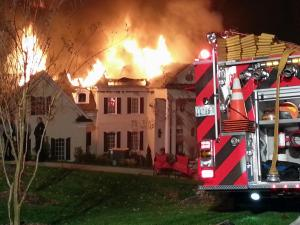 Emergency crews respond to a house fire at 1000 Swithland Court in Raleigh on Wednesday night, Nov. 21, 2012. (Photo by Adam Owens)
