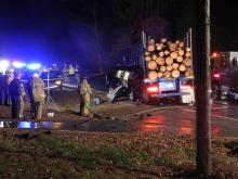 A man was killed Tuesday evening when he ran his car into the side of a tractor-trailer carrying cut logs outside Vass in Moore County, authorities said. Photo courtesy: Aberdeen Times