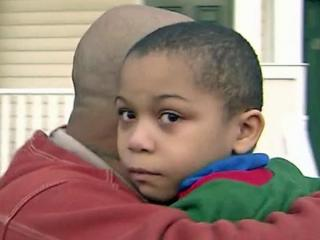 Thomas Washington, 5, is reunited with his father on Sunday, Dec. 2, 2012, after going missing about three hours earlier from their Elizabeth Street home.