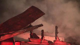 The roof of a home at 2012 Ashe St. in Durham was destroyed in an early-morning fire.