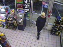 This security camera photo shows a man robbign the Circle K on June 22, 2011.
