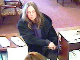 Fayetteville police are looking for this woman in connection with a robbery at the Fort Bragg Federal Credit Union.