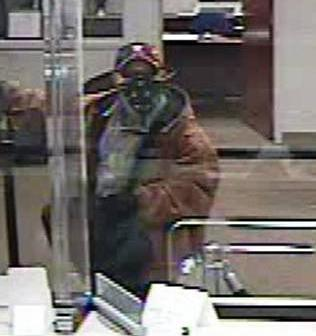 Security photos of a man wanted in the attempted robbery of BB&T at 2507 Bragg Blvd. on Jan. 3, 2013.