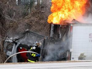 Emergency personnel respond to a wreck involving a van and a semi-tractor trailer on I-95 South near the 115 mile marker, Jan. 12, 2013. Area volunteer firefighters work to extinguish a blaze that burns the semi-tractor trailer after it swerved off the interstate onto the embankment. Serious injuries are reported. (Photo courtesy of Wilson Daily Times)