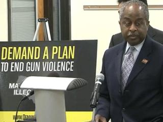 Durham Mayor Bill Bell addresses the media during a news conference for Mayors Against Illegal Guns