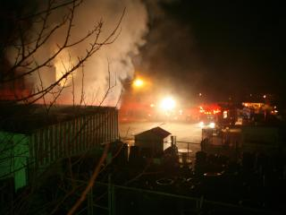 Rick's Used Tires, in the 100 block of North George Street in Goldsboro, caught fire late Monday evening. (Photo by David Cain.)