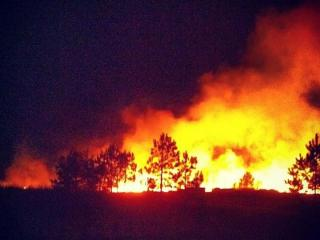 A huge brush fire is burning in a field on Anna Street in Lillington Wednesday night, according to Harnett County dispatchers.