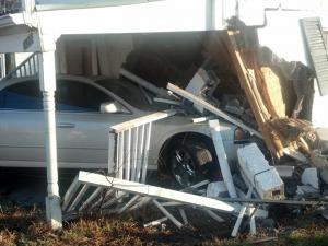 A car crashed into a home in Durham Sunday, but no one was injured, authorities said.
