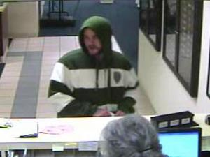 Police were searching Thursday for a man who robbed a State Employees Credit Union branch in Fuquay-Varina, a town spokeswoman said.