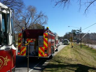Fire trucks line Raleigh's New Bern Avenue Saturday.