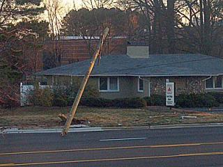A utlity pole fell on a power line in Durham early Sunday after hit it, causing about 800 people to be without electricity for several hours. (User-submitted photo)